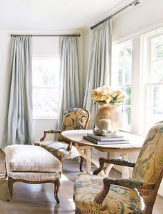 A beautiful gray, textured linen, and tapestry chairs. Gorgeous!