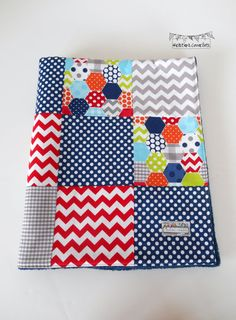 Baby Boy scrappy minky backed patchwork sewn in Riley Blake cotton prints. Backed with Shannon Fabrics' navy Cuddle Dot Minky and interlined with Warm & Natural cotton batting. This is a one-of-a-kind blanket!