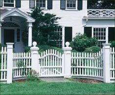 Gate and Historical Fence - Walpole�s skill in replicating this historical fence included distinctive molding detail on the top rail, a grade rail, and special radius-curved sections leading to a convex-top gate.