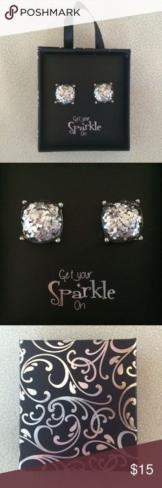 "Silver Glitter Stud Earrings These are beautiful larger silver glitter stud earrings. There is material over the glitter so that it can't be rubbed off. The box says ""Get your sparkle on"". This comes in a cute gift box. Jewelry Earrings"