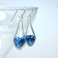 Royal blue elongated tear drop sterling silver glass earrings. $35.00, via Etsy.