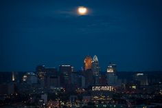"""NASA photographer Bill Ingalls, who was in Cincinnati to take pictures during Apollo 11 moonwalker Neil Armstrong's family memorial ceremony on Aug. 31, snapped this picture of the """"blue moon"""" hanging over the Queen City's skyline."""