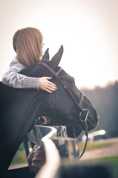 Love this picture! The fence line does a good job of drawing your eye to the girl and her horse.