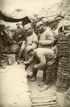 WW1. French soldiers in a front line trench warm some wine. © Harriet Chalmers Adams/National Geographic Creative. Picture Id: 603404