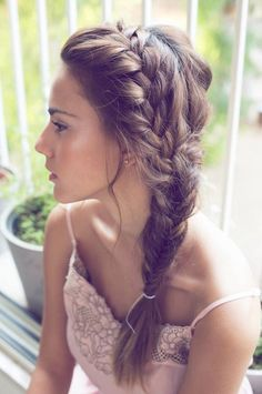 Boho Braid: Especially great in warmer climates, this look is perfect for any one going for the boho vibe. | Photo by Sharon Kahana Photography | See more hairstyles for long hair here: http://www.mywedding.com/articles/10-wedding-hairstyles-for-long-hair/