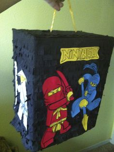 Ninjago Pinatas are nowhere to be bought ...so I made one using instructions at http://fancyfrugally.blogspot.com/2009/09/how-to-make-pull-string-pinata-from.html
