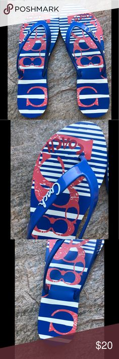 "Never Worn Blue Coach Flip Flops Blue, white, and light red flip flops. Striped pattern with the Coach logo design. Plastic blue toe-thong with white ""Coach"" wording. Cute design on the bottoms. New without tags. A slight mark up on the bottom from silver marker, but not noticeable when worn. Medium width. From a smoke free, pet free home. Coach Shoes Sandals"