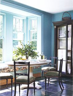 window seat banquette in lovely blue room (AD)