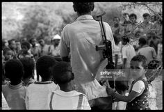 At a school for orphans and children of EPLF fighters, a little girl clings to her armed father's shirt during a surprise visit, 27th June 1978.