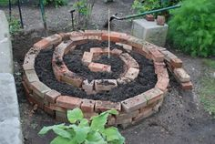 how to begin a spiral garden. For all of the extra bricks we have Spiral Garden, Brick Garden, Outdoor Projects, Garden Projects, Outdoor Decor, Garden Ideas, Backyard, Patio, Dream Garden