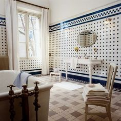 A classic bathroom with blue ceramic tiles and white walls