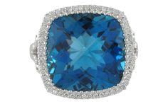 Hot this season. 18k white gold London blue topaz ring. This topaz is over 13 carats (13.71ct) with a third of a carat total in diamonds.