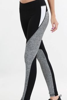 'Kingpin' Color Block Leggings - Bowl everyone away in these amazing melange color block pants and and drop a kingpin move in the house. In a unique geometric blocking of black and grey throughout the legs and a contrast white on the outer thigh, these pants will always be in the pocket! So get a six pack on your abs and in the bowling alley - its a win win situation. Available in Black/Grey/White. 87% Nylon and 13% Spandex.