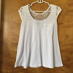 White: Size Medium Brand Rue 21 Flare Lace shirt Adorable white t-shirt like shirt with lace/knit embellishments. Great condition, just has small light tan stain, hardly noticeable! Great for summer!!! Flirty lace back Rue 21 Tops Tees - Short Sleeve