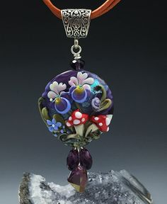 Hey, I found this really awesome Etsy listing at https://www.etsy.com/listing/222197716/iris-and-mushroom-fairy-garden-lampwork