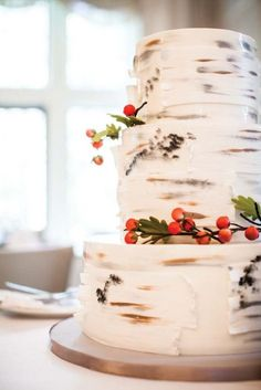 How cool is this birch bark wedding cake?!  Really beautiful wedding ideas in this article, Disney Inspired Wedding #7 :: Brave Themed Wedding (Scottish, Gaelic), on the site Kasper Creations