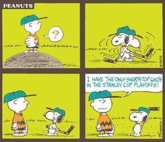 playing hockey cartoon strip snoopy