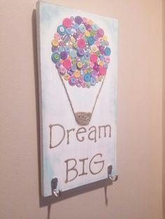 Get this cute handmade sign for your little girl's room. All handmade. I painted it with a base of white then added some buttons and glitter and rhinestones. The basket and the strings of the Hot air