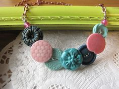 Vintage Button Necklace, Pink, Blue, and Turquoise Colors. $10.00, via Etsy.