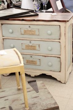 stained top, white painted sides, blue drawers
