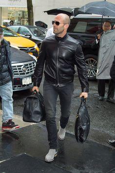 Jason Statham looking stylish and wearing a leather jacket.
