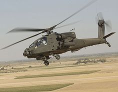 The Boeing AH-64 Apache is a four-blade, twin-engine attack helicopter with a tailwheel-type landing gear arrangement, and a tandem cockpit for a two-man crew. Originally, the Apache started life as the Model 77 developed by Hughes Helicopters for the United States Army's Advanced Attack Helicopter program to replace the AH-1 Cobra, and was first flown on 30 September 1975.