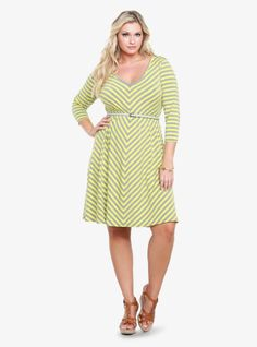 Limeade and grey mitered stripes create bold pattern on this long-sleeved knit dress. A softly shirred waist and a taupe skinny belt shape and style the easy silhouette.