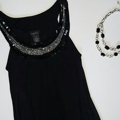 Black tank with sequin neckline Rayon/spandex. All sequins are intact. No stains or tears. Stretch band at hemline so it sits on hips perfectly. Very cute with pants and heels! Rue 21 Tops Tank Tops