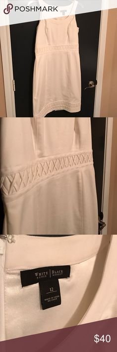 Super cute White House Black Market dress! This is a perfect dress for spring! White with cute detail, this dress was worn once and is in great condition! White House Black Market Dresses Midi