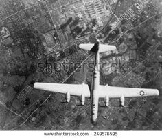 American Super Fortress bomber over Nakajima Aircraft Co. On the ground, smoke marks it's bombing impacts. Code Name Verity, Military Terms, Us Army, Poster Wall, Custom Framing, Wind Turbine, Wwii, Royalty Free Stock Photos, Wall Art