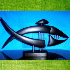 Fish statuemade with wood by GalleriaCentral on Etsy, $75.00