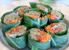 The Global Girl Raw Vegan Recipes: Veggie Wrap with Pumpkin Seed & Mint Patty in a collard green leaf with tomato, shredded carrot, red onion and sprouts.