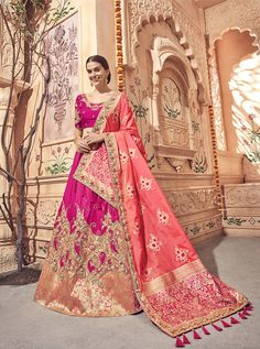 Rani pink and coral pink lehenga choli with dupatta. Work - Heavy embroidery work on lehenga, choli and dupatta. To complete the look matching choli and dupatta is available with this product. Banarasi Lehenga, Pink Lehenga, Bridal Lehenga Choli, Peach Party, Eid Outfits, Party Wear Lehenga, Lehenga Choli Online, Pink Silk, Green Silk