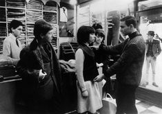 A 'Mod' girl gets measured for a suit.   Photography by Keystone Features, May 1964, Carnaby Street, London