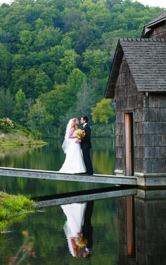 Alexis and Blaine tied the knot at The Camp at the Eseeola Lodge, a large log cabin on a grassy hill overlooking a boathouse and a lake with the Blue Ridge Mountains in the distance.