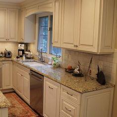 Tile Backsplash With Giallo Ornamental Granite Countertops
