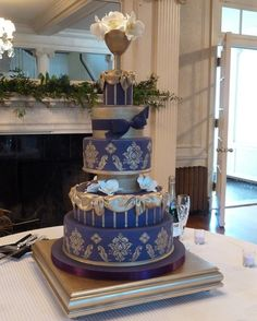 purple & gold wedding cake by RebeccaSutterby, via Flickr