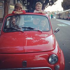 cute little family in a tiny little fiat