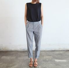 Grey dress pants with a muscle tee. way to dress down or up- whichever you may need.