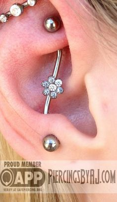Healed rook to anti tragus industrial with CZ flower.