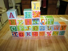 Here is a site with step by step instructions to make your own DIY alphabet blocks. Perfect baby shower craft or gift.