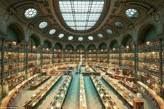Not homes, but libraries.  Still gorgeous!   Photographer, Franck Bohbot, captured some of the world's most beautiful libraries, including the Bibliothèque Nationale de France in Paris