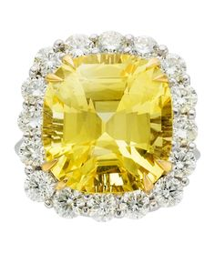 Sapphire, Diamond, Platinum, Gold Ring The ring features a cushion-shaped yellow sapphire measuring 15.69 x 14.31 x 9.65 mm and weighing 17.53 carats, enhanced by full-cut diamonds weighing a total of approximately 1.90 carats, set in platinum and 18k gold. A GRS Laboratory report # GRS2012-012497 dated January 10, 2012 stating Natural Sapphire, Origin Sri Lanka, No Indication of Thermal Treatment accompanies the center stone.