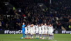 Newcastle's players pictured standing for the minute's silence at the KCOM Stadium before Tuesday night's tie