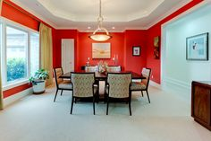 Formal dining room with modern and clean interior design and an abundance of light. Designed and built by Ramage Company.