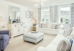Coastal Interior Designed Living Room scheme, cottage style.   Chalk white linen loose covered sofas, french painted bureau, french linen and blue flower pillows,  beautiful fresh scheme.  David Wilson Homes 2016  #dwh #davidwilsonhomes #showhomes #interiordesign #cotswolds #coastaltheme