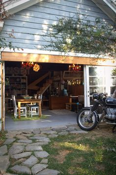 A garage turned into a guest house.  I really like the idea of being able to open up an entire wall in my house.