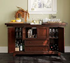 Torrens Bar Cabinet | Pottery Barn-would potentially prefer a bar cabinet like this over a china cabinet