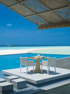 This is the Four Seasons Resort at the Maldives Islands... nothing else to write, just look at the picture! =)