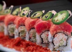 Lotus on Fire Roll: Spicy Tuna, Lotus Root, and Jalapeno on top of California roll.